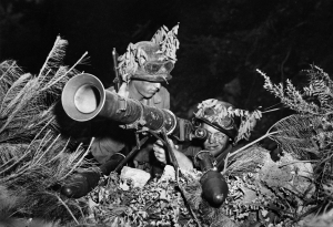 Two American soldiers lined up a rocket launcher bazooka along a battlefront in Korea in July 1950. United States Army
